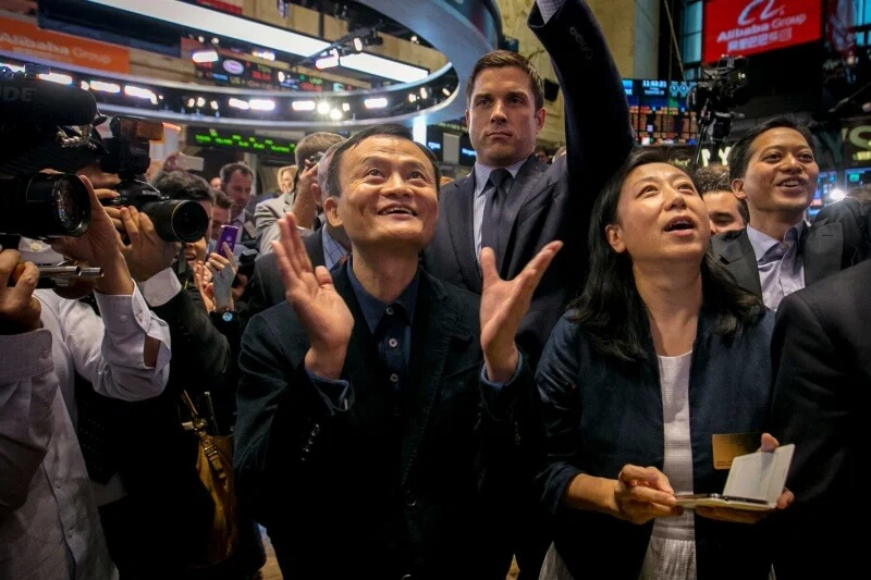 Alibaba Group Holding Ltd founder Jack Ma and Chief Financial Officer Maggie Wu react as the company's initial public offering, under the ticker BABA, begins trading at the New York Stock Exchange in New Y